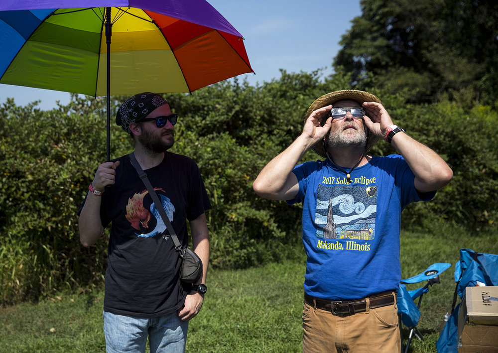 Jacob Gritter-Darr and his father, John Gritter drove from Kalamazoo, Mich. to watch the solar eclipse in Giant City State Park near Carbondale, Ill. Monday, Aug. 21, 2017. [Rich Saal/The State Journal-Register]