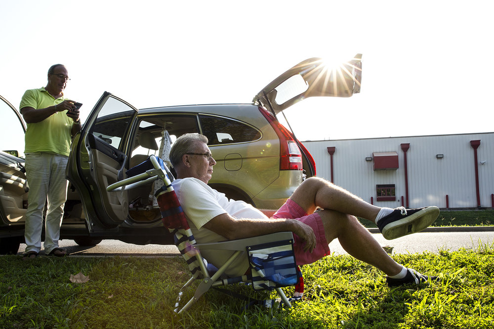 Rick Kasprzak, left, and Jim Lawless, drove overnight from Chicago and arrived in Carbondale before dawn Monday, Aug. 21, 2017 to watch the solar eclipse. They joined others who parked behind a Huck's Convenient Store. [Rich Saal/The State Journal-Register]