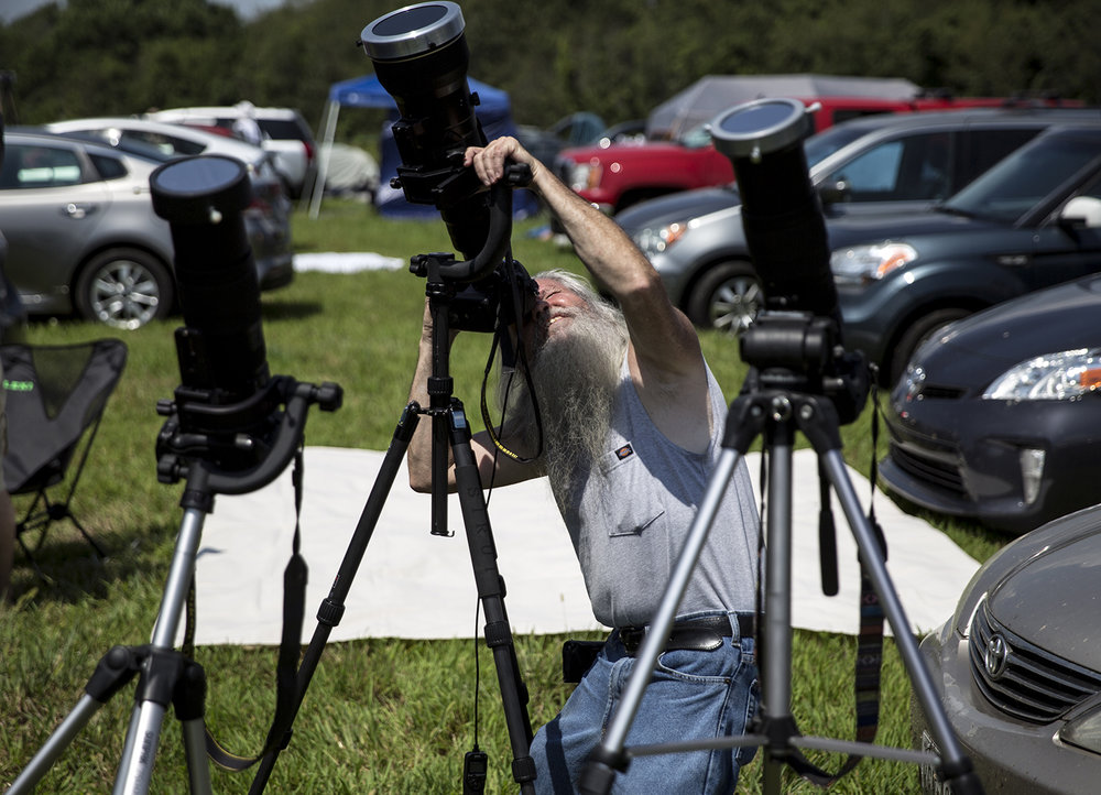 Jim Smith, from Alton, photographs the solar eclipse at Giant City State Park near Carbondale Monday, Aug. 21, 2017. [Rich Saal/The State Journal-Register]