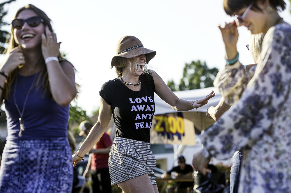 Kelly Downes dances to the music at the Eclipse Marketplace in downtown Carbondale Saturday, Aug. 19, 2017. Ted Schurter/The State Journal-Register