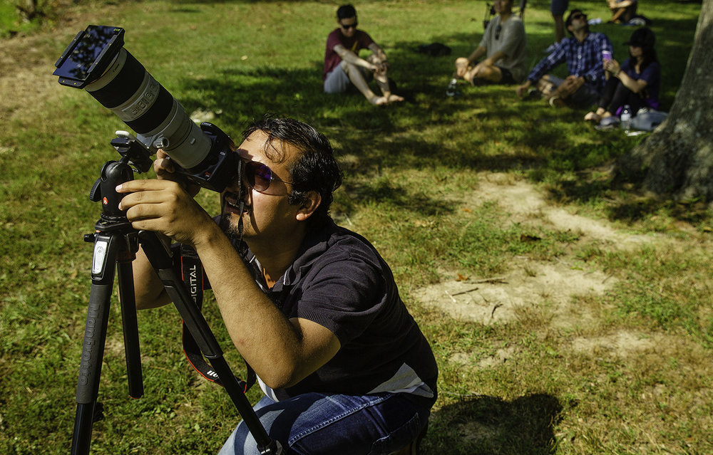 Souman Chatz of Chicago, Ill., prepares his camera for the total solar eclipse at Evergreen Park in Carbondale, Ill., Monday, Aug. 21, 2017. [Ted Schurter/The State Journal-Register]