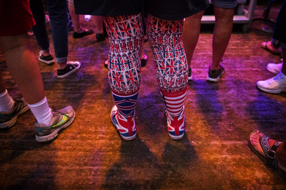 A Herman's Hermit fan sports Union Jack leggings and other English accents as she attends the concert at the Illinois State Fair Monday, Aug. 14, 2017. The English beat rock band formed in Manchester in 1964. [Ted Schurter/The State Journal-Register]