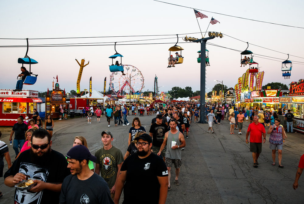 The line of fans streaming down Illinois Avenue all the way past The Shed waiting to get in to see Five Finger Death Punch perform on the Grandstand Stage at the Illinois State Fairgrounds, Saturday, Aug. 19, 2017, in Springfield, Ill. [Justin L. Fowler/The State Journal-Register]