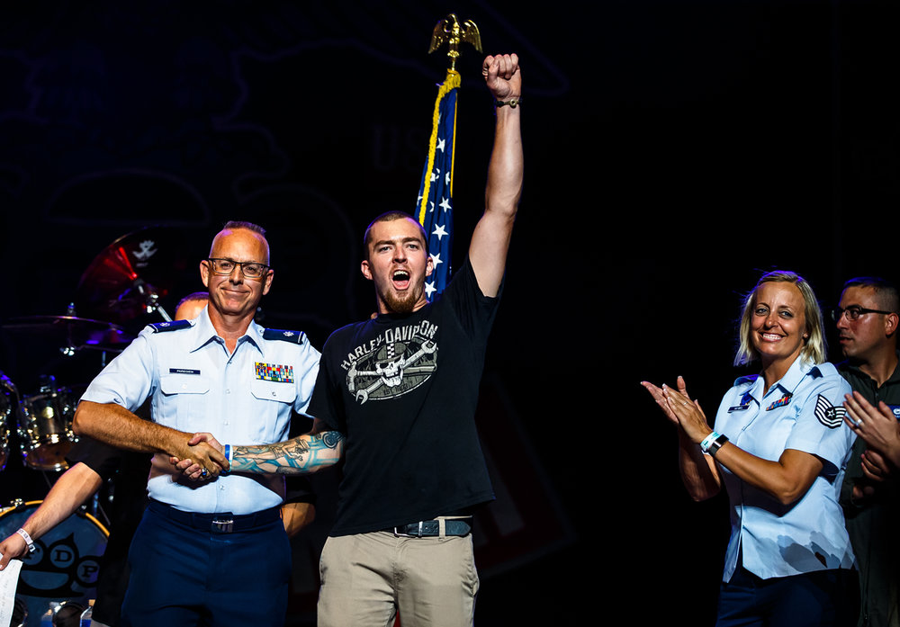 Joey Gatons of Pana, Ill, took his oath to join the Air Force on stage prior to the Five Finger Death Punch concert on the Grandstand Stage at the Illinois State Fairgrounds, Saturday, Aug. 19, 2017, in Springfield, Ill. [Justin L. Fowler/The State Journal-Register]