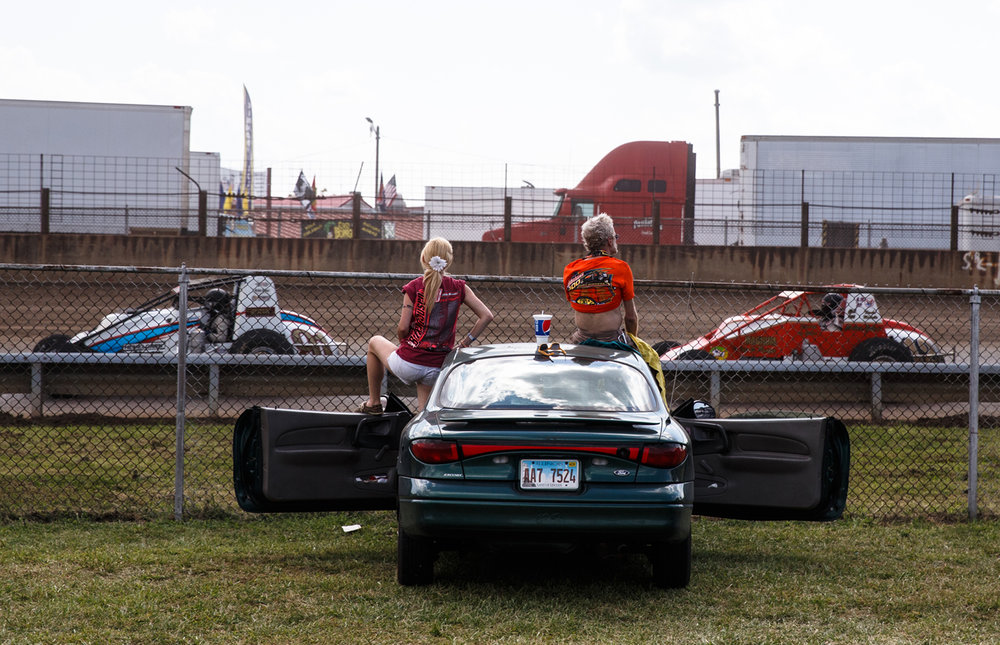 Fans take in the race from the infield near turn one during the USAC Silver Crown Bettenhausen 100 on the Springfield Mile at the Illinois State Fairgrounds, Saturday, Aug. 19, 2017, in Springfield, Ill. [Justin L. Fowler/The State Journal-Register]