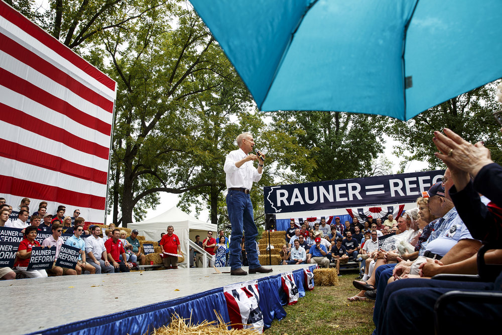 Gov. Bruce Rauner speaks at the Republican Day rally at the Illinois State Fair Wednesday, Aug. 16, 2017. Light rain drops brought out a few umbrellas. [Rich Saal/The State Journal-Register]