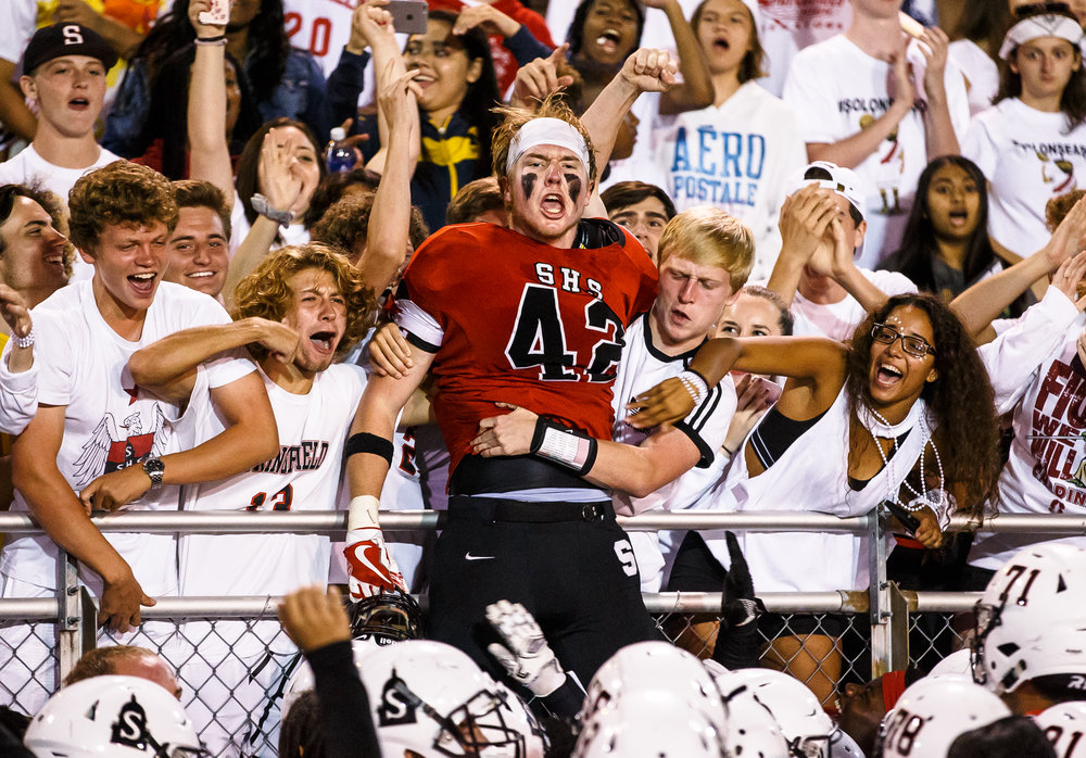 Springfield's David Brandt (42) celebrates with the student section after Springfield defeated Normal U-High 42-21 at Memorial Stadium, Friday, Aug. 25, 2017, in Springfield, Ill. [Justin L. Fowler/The State Journal-Register]