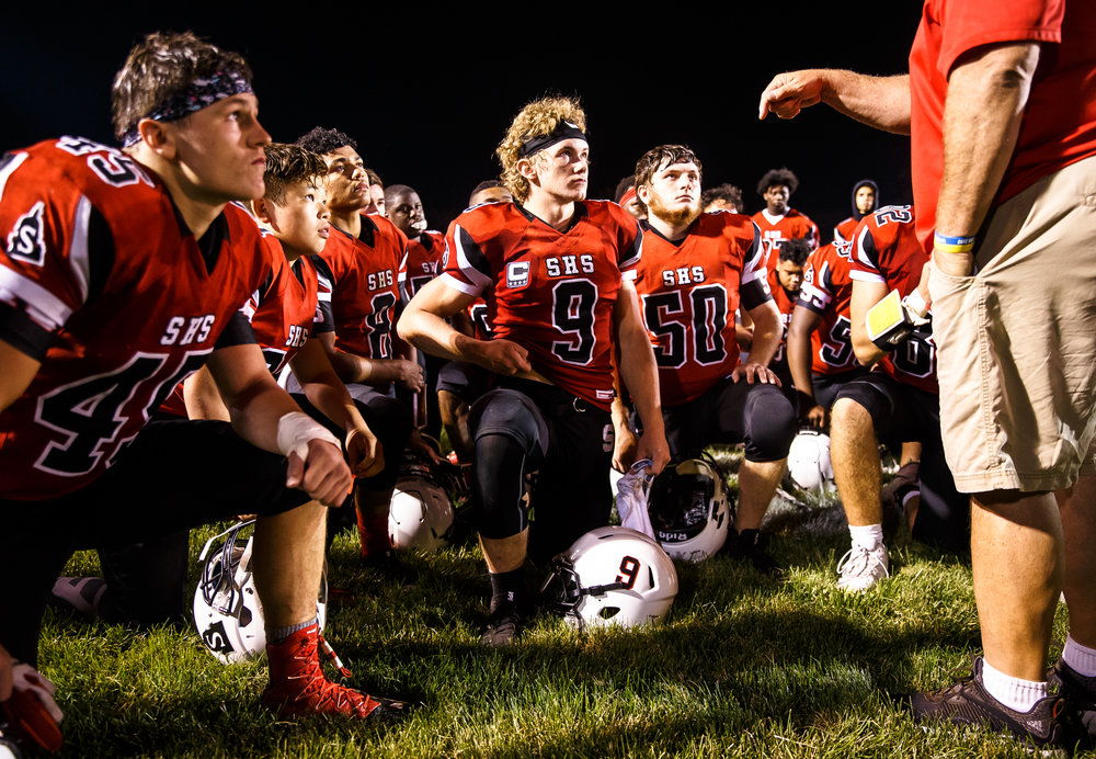 Springfield's Lucas Rockford (9) listens to the coaches with his teammates after Springfield defeated Normal U-High 42-21 at Memorial Stadium, Friday, Aug. 25, 2017, in Springfield, Ill. [Justin L. Fowler/The State Journal-Register]