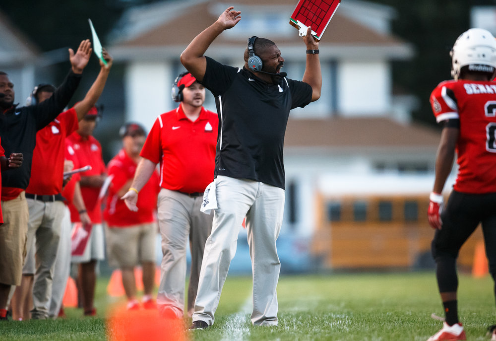Springfield football head coach Roy Gully III reacts after a no call on a late hit from Normal U-High in the first quarter at Memorial Stadium, Friday, Aug. 25, 2017, in Springfield, Ill. [Justin L. Fowler/The State Journal-Register]