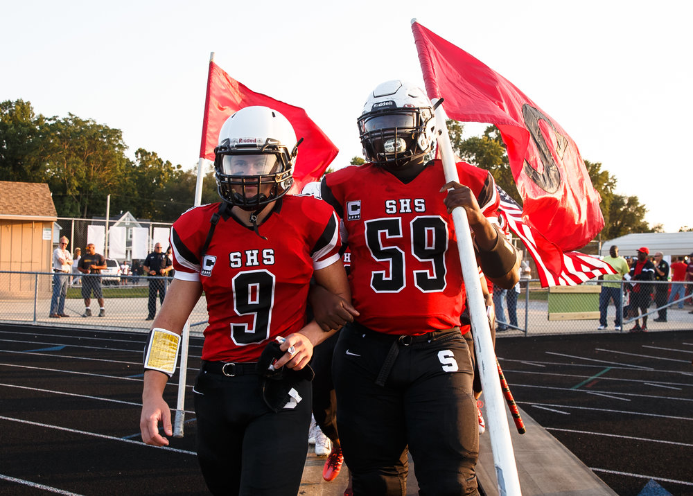 Springfield's Lucas Rockford (9) and Springfield's Ja'Quez Roberson (59) lead the Senators on the field to take on Normal U-High at Memorial Stadium, Friday, Aug. 25, 2017, in Springfield, Ill. [Justin L. Fowler/The State Journal-Register]