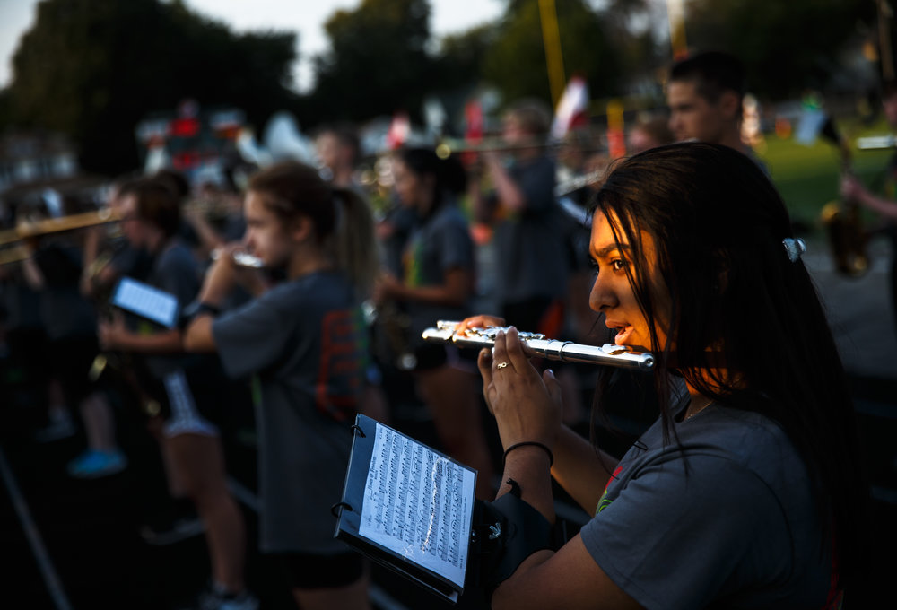 Springfield High School junior Simran Shailesh plays the flute in the Springfield High School Marching Band as they perform prior to kickoff between Springfield and Normal U-High at Memorial Stadium, Friday, Aug. 25, 2017, in Springfield, Ill. [Justin L. Fowler/The State Journal-Register]