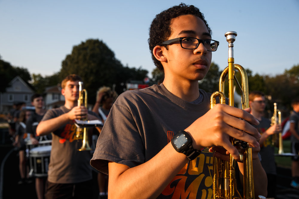 Springfield High School junior Joshua Frisbie gets set with his trumpet and the Springfield High School Marching Band as they prepare to perform prior to kickoff between Springfield and Normal U-High at Memorial Stadium, Friday, Aug. 25, 2017, in Springfield, Ill. [Justin L. Fowler/The State Journal-Register]