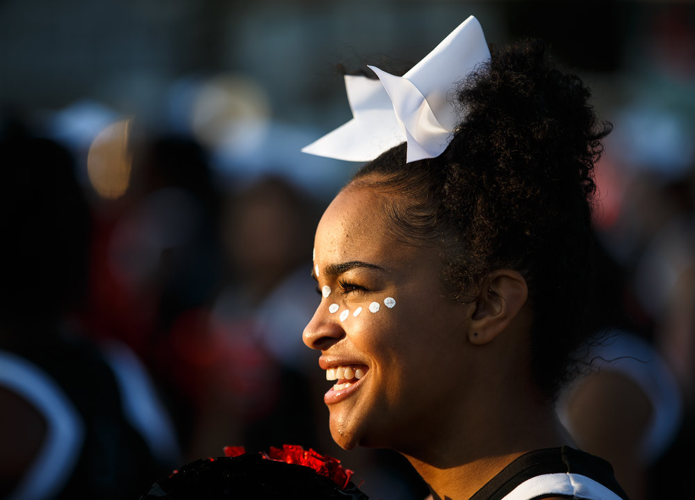 Springfield High School junior cheerleader Avery Allen smiles as she gets ready for kickoff with her fellow cheerleaders for the Springfield vs. Normal U-High game at Memorial Stadium, Friday, Aug. 25, 2017, in Springfield, Ill. [Justin L. Fowler/The State Journal-Register]