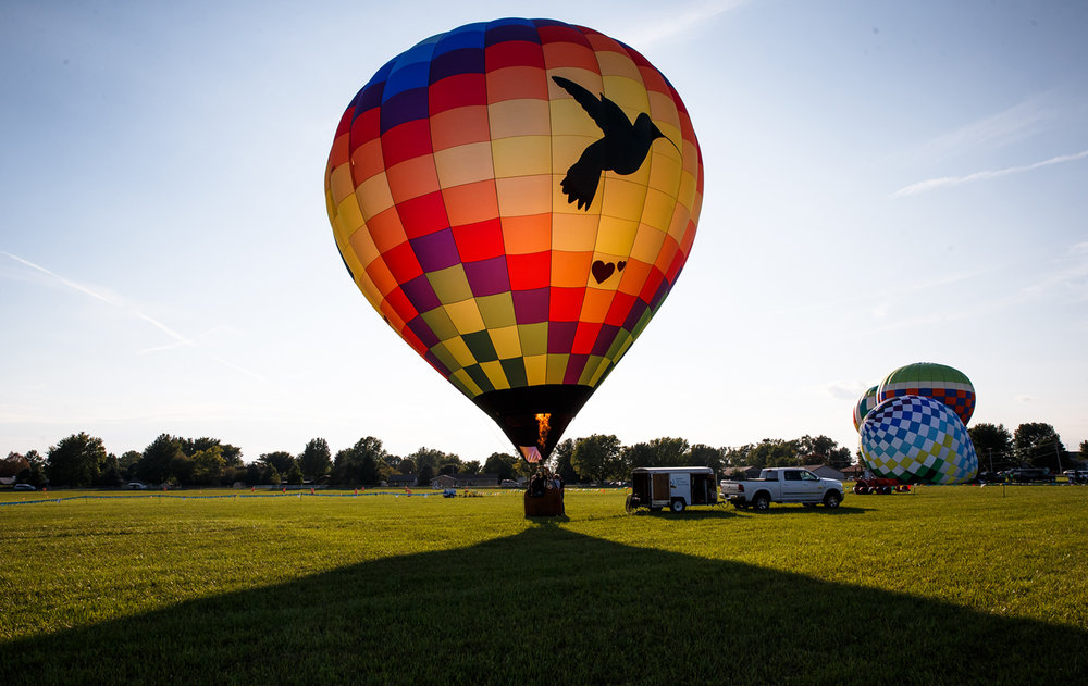 """Memories In Flight"" begins to lift off the ground for a flight following a ribbon cutting ceremony for the Lincoln Balloon Festival at the Logan County Airport, Thursday, Aug. 24, 2017, in Lincoln, Ill. The symbols on the exterior of the balloon represent friends and family of the owners who have passed away. [Justin L. Fowler/The State Journal-Register]"
