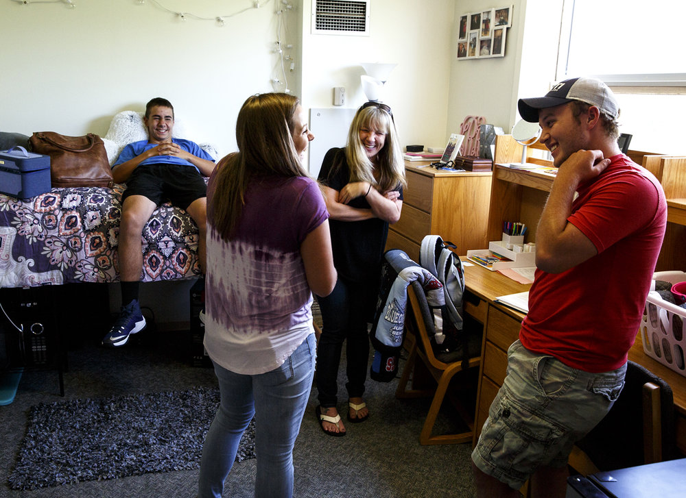 Katie Ramsey gets settled into her new dorm room in the Lincoln Residence Hall on the University of Illinois Springfield campus Wednesday, Aug. 22, 2017, after being moved in with help from her boyfriend, Zack Kirkman, right, and her mom Kelly and brother Aidan. Ramsey, a freshman, is from Thompsonville. She is one of about 250 first-year students who arrived for the fall semester, which begins on Monday. [Rich Saal/The State Journal-Register]