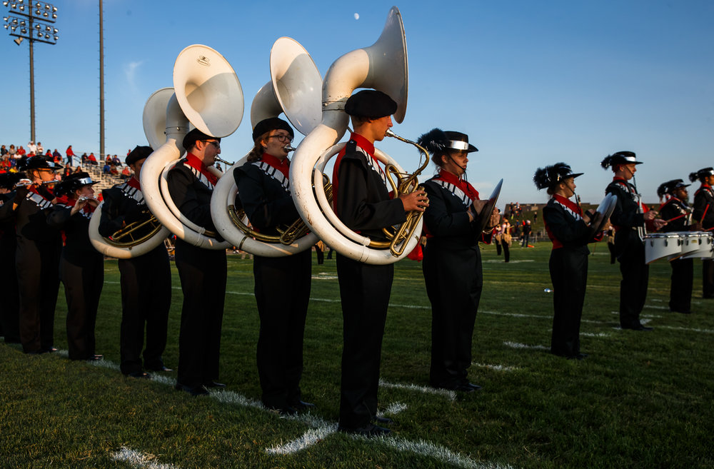 Glenwood freshman Kale Tish plays the tuba in the marching band as they take the field to play in the Titans against Rochester at Glenwood High School, Friday, Sept. 1, 2017, in Chatham, Ill. [Justin L. Fowler/The State Journal-Register]