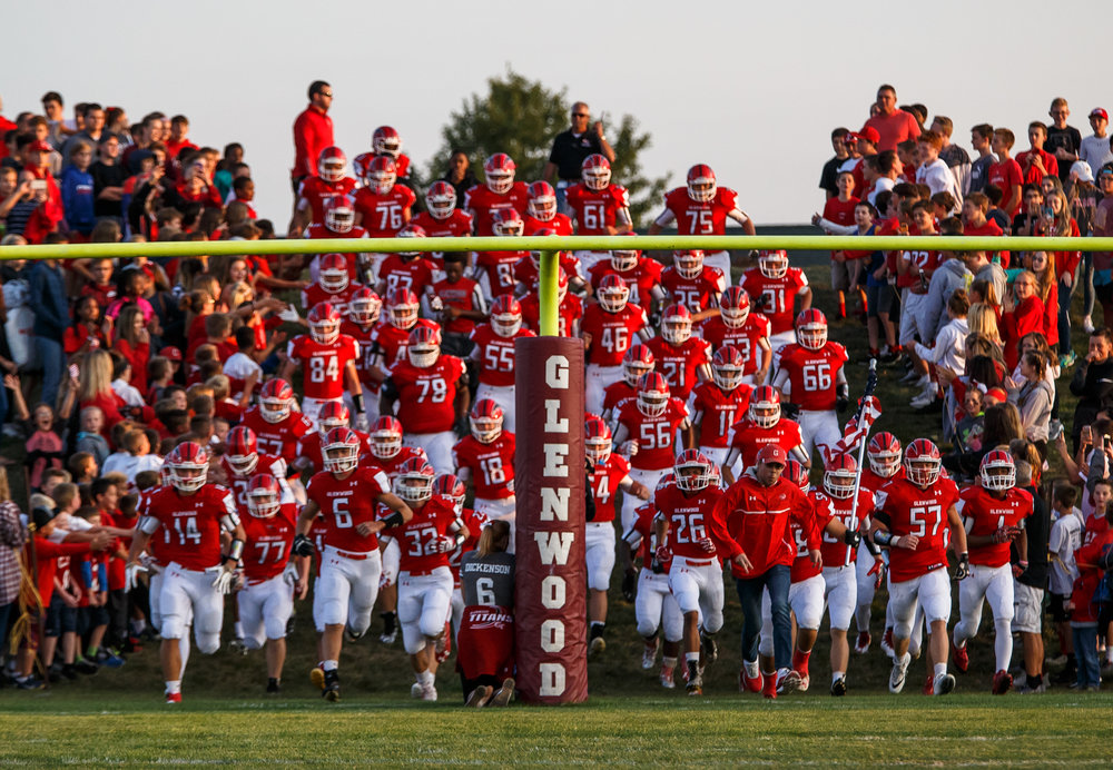 The Glenwood Titans charge on to the field to take on the Rochester Rockets at Glenwood High School, Friday, Sept. 1, 2017, in Chatham, Ill. [Justin L. Fowler/The State Journal-Register]