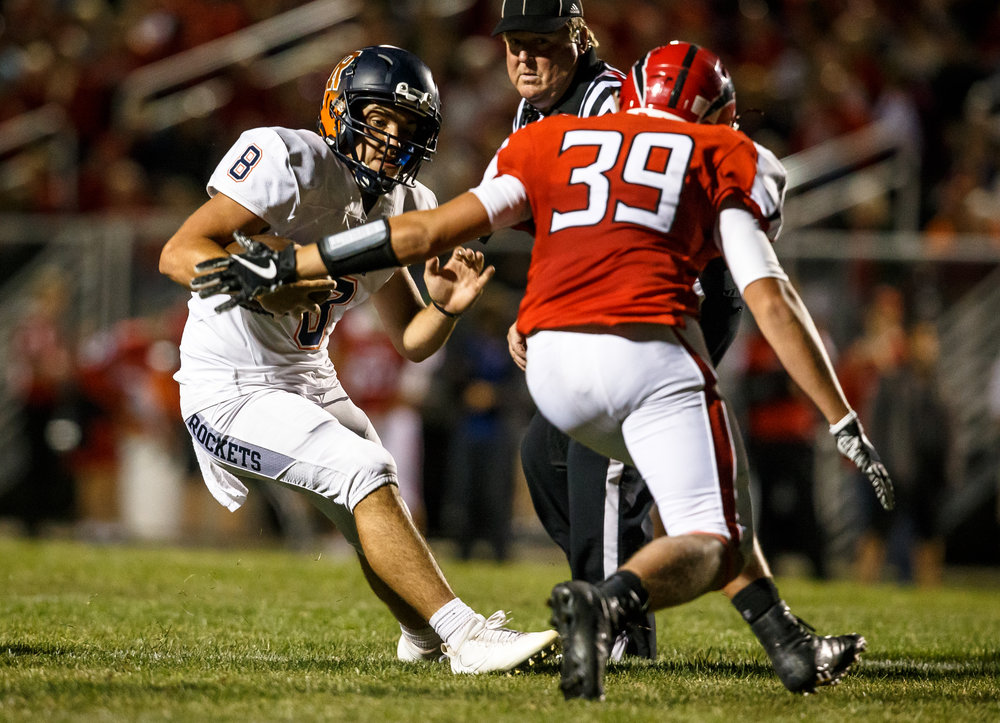 Rochester quarterback Nic Baker (8) stops in his tracks to make Glenwood's Alex Butler (39) miss a tackle on a rush in the second quarter at Glenwood High School, Friday, Sept. 1, 2017, in Chatham, Ill. [Justin L. Fowler/The State Journal-Register]