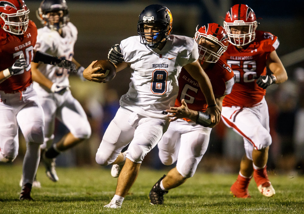 Rochester quarterback Nic Baker (8) breaks a tackle from Glenwood's Connor Dickenson (6) on a rush in the second quarter at Glenwood High School, Friday, Sept. 1, 2017, in Chatham, Ill. [Justin L. Fowler/The State Journal-Register]
