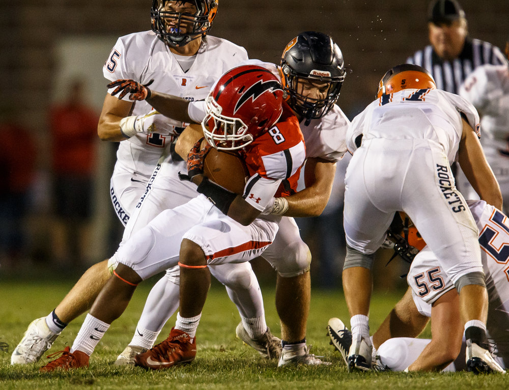 Glenwood's Jason Hansbrough (8) is brought down by Rochester's Mike McNicholas (85) on a rush in the second quarter at Glenwood High School, Friday, Sept. 1, 2017, in Chatham, Ill. [Justin L. Fowler/The State Journal-Register]