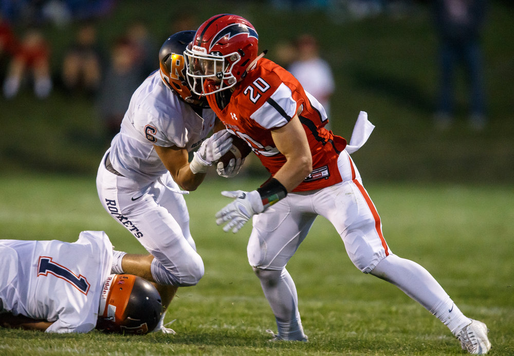 Glenwood's Austin Schiff (20) tries to break a tackle from Rochester's Cade Eddington (6) on a rush in the second quarter at Glenwood High School, Friday, Sept. 1, 2017, in Chatham, Ill. [Justin L. Fowler/The State Journal-Register]