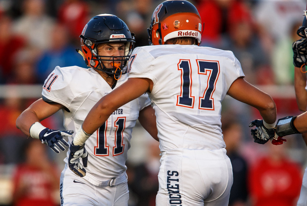 Rochester's Skylor Caruso (11) and Rochester's Ben Chapman (17) are fired up after making a tackle against Glenwood in the first quarter at Glenwood High School, Friday, Sept. 1, 2017, in Chatham, Ill. [Justin L. Fowler/The State Journal-Register]