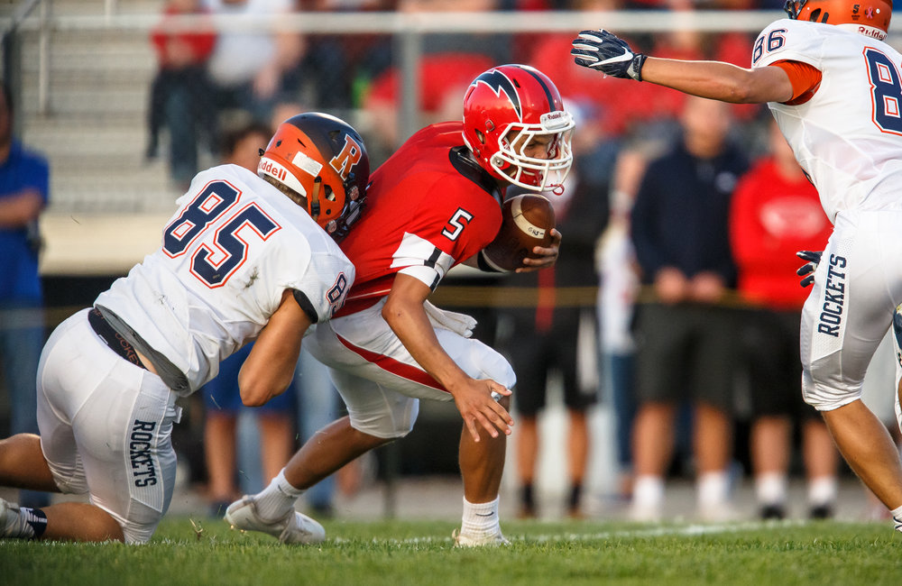 Glenwood's Luke Lehnen (5) is sacked by Rochester's Mike McNicholas (85) in the first quarter at Glenwood High School, Friday, Sept. 1, 2017, in Chatham, Ill. [Justin L. Fowler/The State Journal-Register]