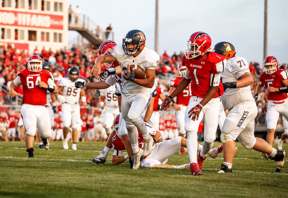 Rochester's Zach Gleeson (30) goes in for the touchdown against Glenwood's Jake Wooldridge (32) in the first quarter at Glenwood High School, Friday, Sept. 1, 2017, in Chatham, Ill. [Justin L. Fowler/The State Journal-Register]