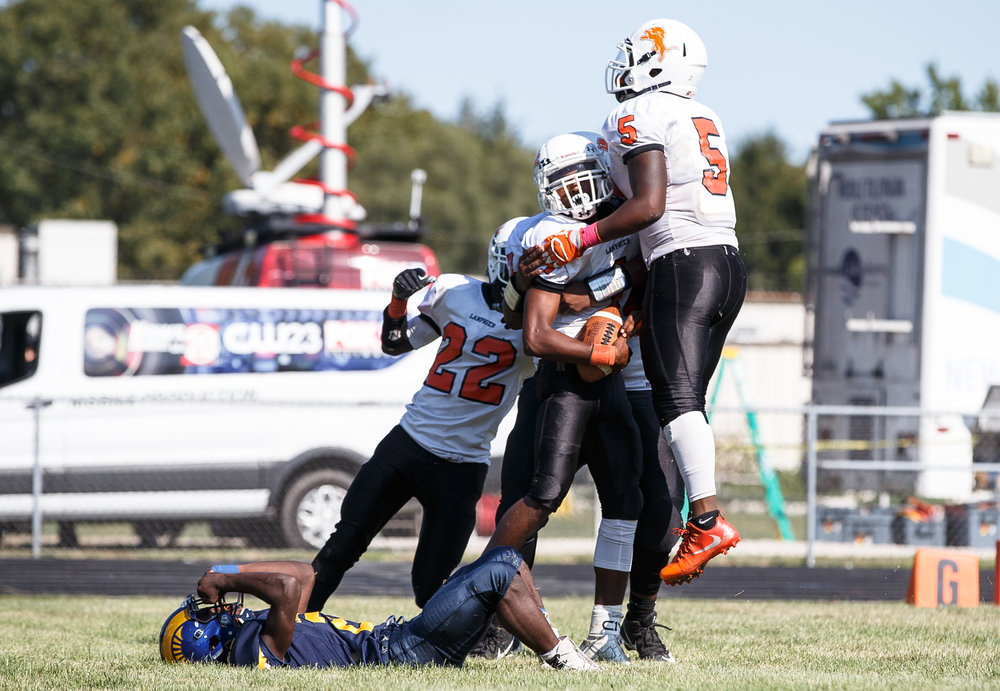 Lanphier's Ajonte Lee (1) celebrates his touchdown with Khalfani Coleman (5) against Southeast in the third quarter at Southeast High School, Saturday, Sept. 2, 2017, in Springfield, Ill. [Justin L. Fowler/The State Journal-Register]