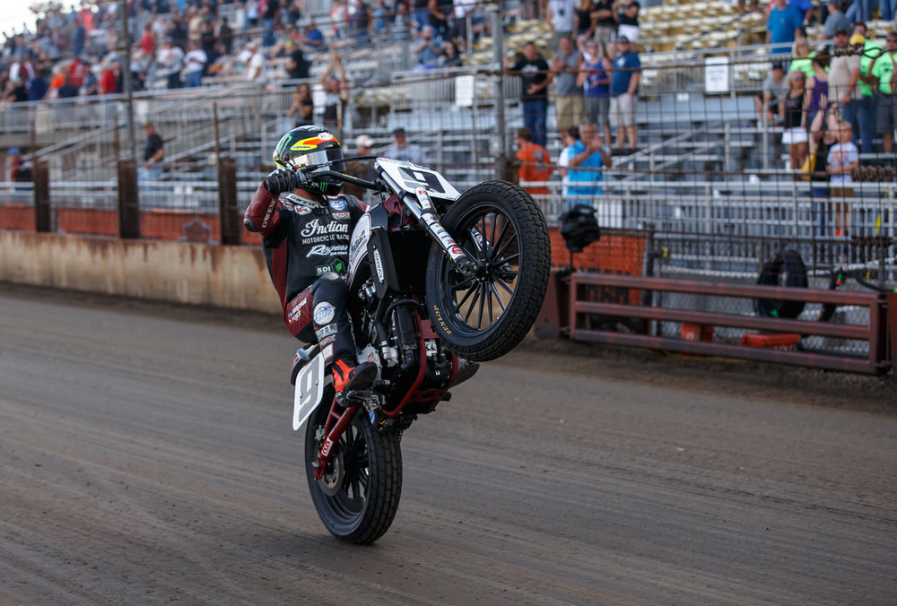 Jared Mees pops a wheelie down the front stretch on his Indian Scout FTR750 after winning the AMA Harley-Davidson Springfield Mile II at the Illinois State Fairgrounds, Sunday, Sept. 3, 2017, in Springfield, Ill. [Justin L. Fowler/The State Journal-Register]