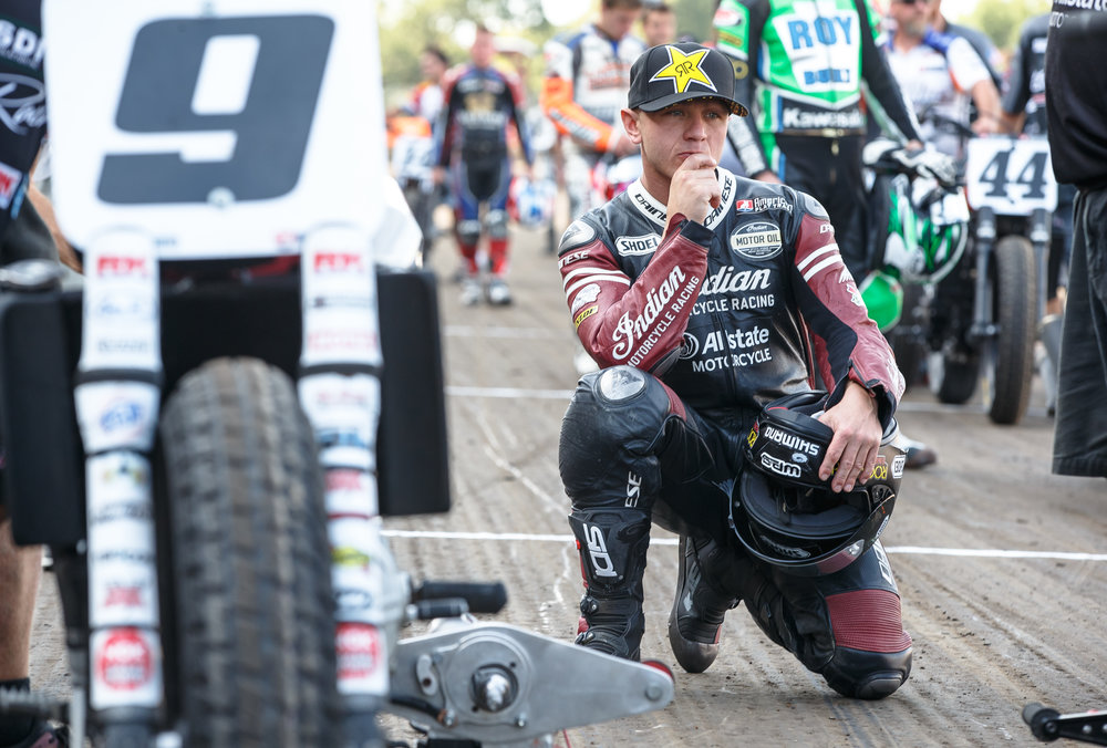 Bryan Smith pauses as riders get set on the starting line grid for the AMA Harley-Davidson Springfield Mile II at the Illinois State Fairgrounds, Sunday, Sept. 3, 2017, in Springfield, Ill. [Justin L. Fowler/The State Journal-Register]