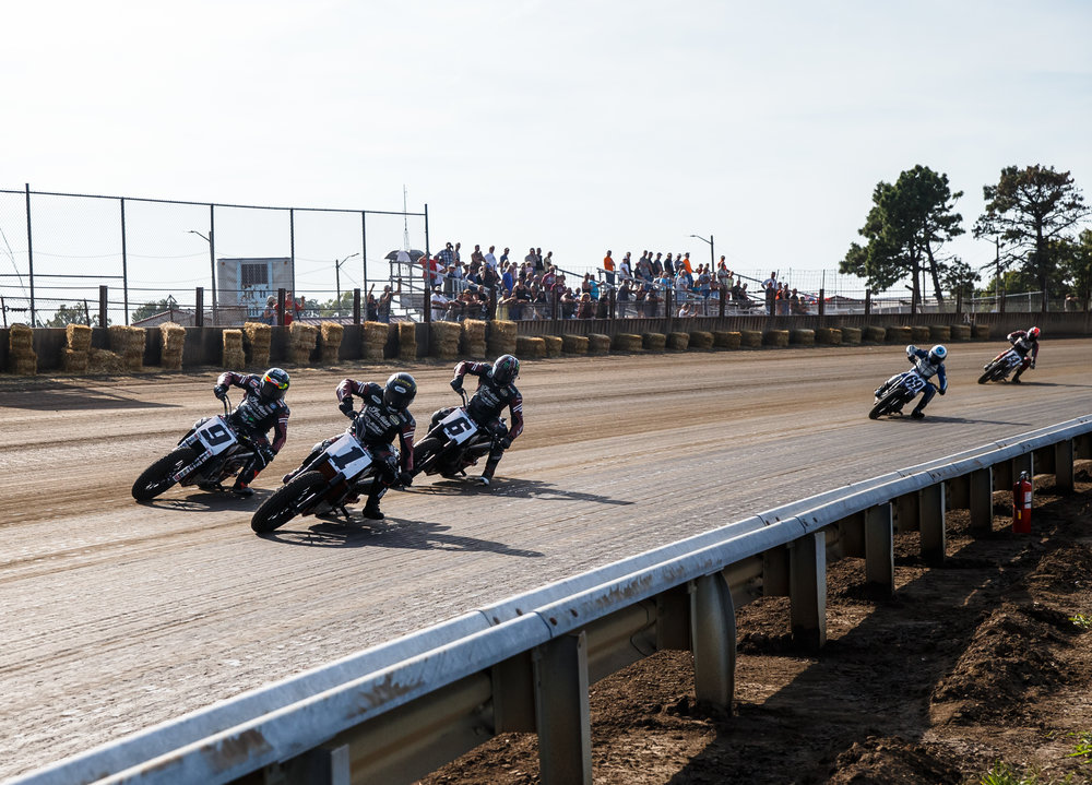 Jared Mees (9), Bryan Smith (1) and Brad Baker (6) lead the pack into turn one, all on Indian Scout FTR750s, during the AMA Harley-Davidson Springfield Mile II at the Illinois State Fairgrounds, Sunday, Sept. 3, 2017, in Springfield, Ill. [Justin L. Fowler/The State Journal-Register]