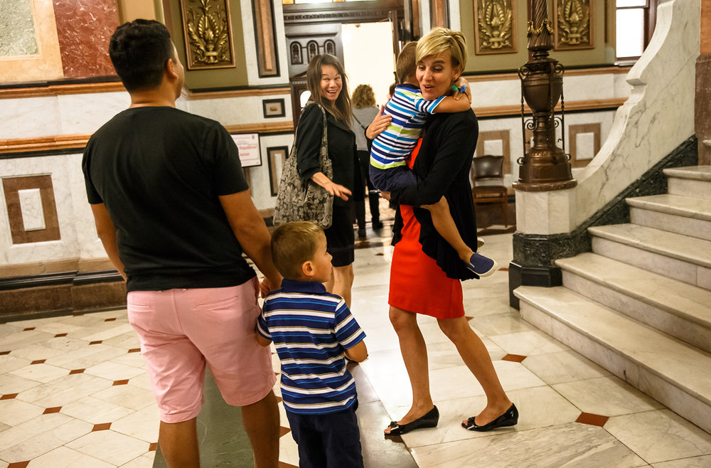 Illinois State Rep. Sara Wojcicki Jimenez, R-Leland Grove, shares a moment with her twins before the Republicans meet for a caucus after a vote the education funding bill fails with a vote of 46-61 during a special session at the Illinois State Capitol, Monday, Aug. 28, 2017, in Springfield, Ill. [Justin L. Fowler/The State Journal-Register]