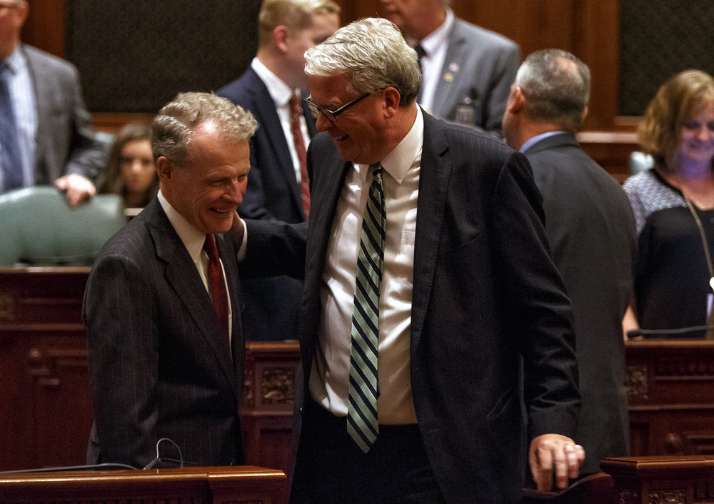 Illinois Speaker of the House Michael Madigan, D-Chicago, visits with Illinois House Minority Leader Jim Durkin, R-Western Springs, on the floor of the Illinois House after the education funding bill passed on the second attempt 73-34-3 during a special session at the Illinois State Capitol, Monday, Aug. 28, 2017, in Springfield, Ill. [Justin L. Fowler/The State Journal-Register]