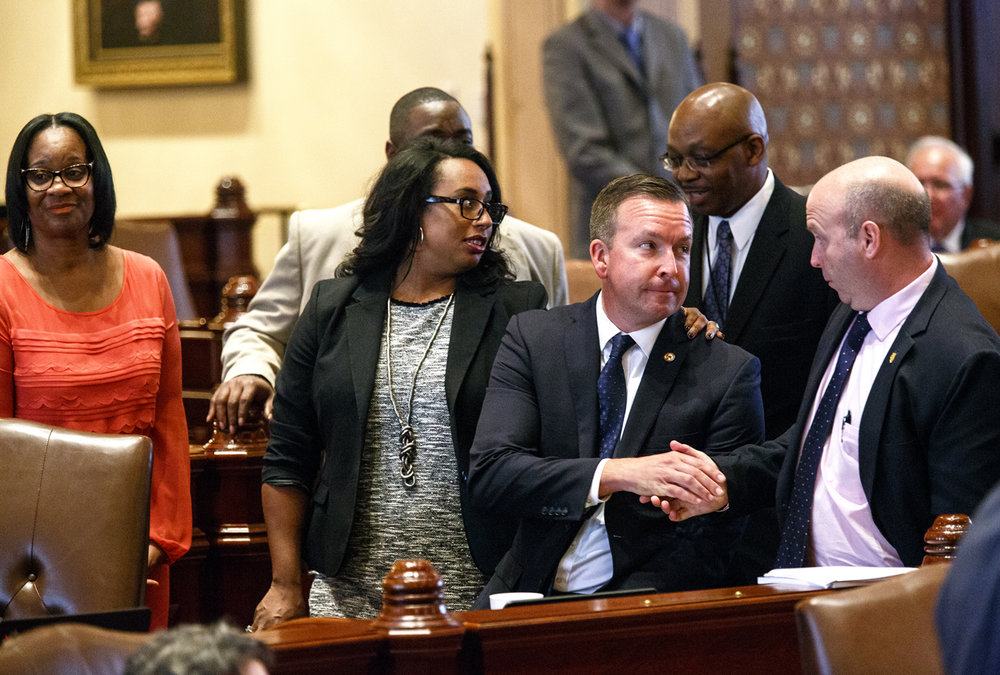 Sen. Andy Manar, center, D-Bunker Hill, is congratulated by colleagues after the Senate approved a landmark education funding reform bill Tuesday, Aug. 29, 2017 at the Capitol in Springfield, Ill. Manar was the Senate sponsor and the chief architect of the new school aid formula. From left are Sen. Kimberly Lightford, D-Westchester, Sen. Toi Hutchinson, D-Chicago Heights and Sen. Thomas Cullerton, D-Villa Park. Behind Manar is Rep. William Davis, D-East Hazel Crest, the bill's sponsor in the House. [Rich Saal/The State Journal-Register]