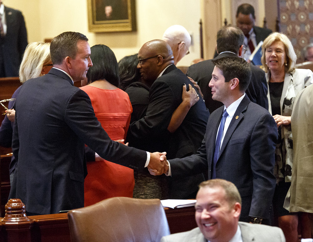 Sen. Jason Barickman, R-Bloomington, right, greets Sen. Andy Manar, D-Bunker Hill, on the floor of the Senate after the chamber approved a landmark education funding reform bill Tuesday, Aug. 29, 2017 at the Capitol in Springfield, Ill. Manar was the Senate sponsor and the chief architect of the new school aid formula. From left are Sen. Kimberly Lightford, D-Westchester, Rep. William Davis, D-East Hazel Crest, the bill's sponsor in the House and Sen. Donne Trotter, D-Chicago. [Rich Saal/The State Journal-Register]