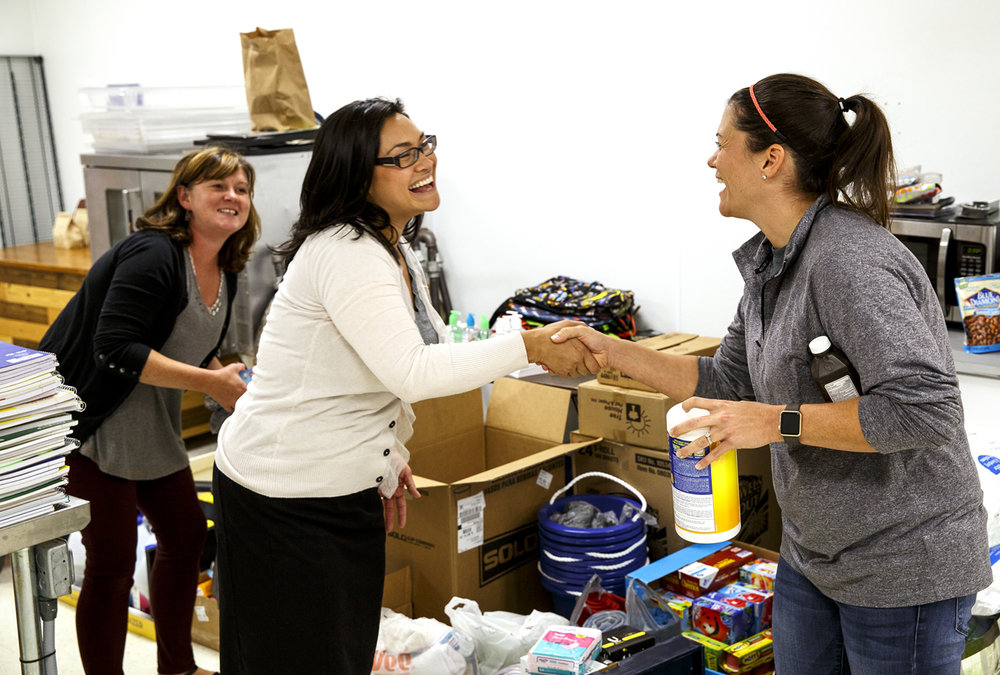 Lisa Hayman, right, a Pleasant Plains native who is a school teacher in Houston, thanks Joanna Coll for the items she dropped off Friday, Sept. 1, 2017 at Custom Cup Coffee in Springfield. Hayman is collecting school supplies and other items that she will distribute to the families of students at her school who have been affected by Hurricane Harvey. At left is Custom Cup co-owner Kendra Boesdorfer. [Rich Saal/The State Journal-Register]