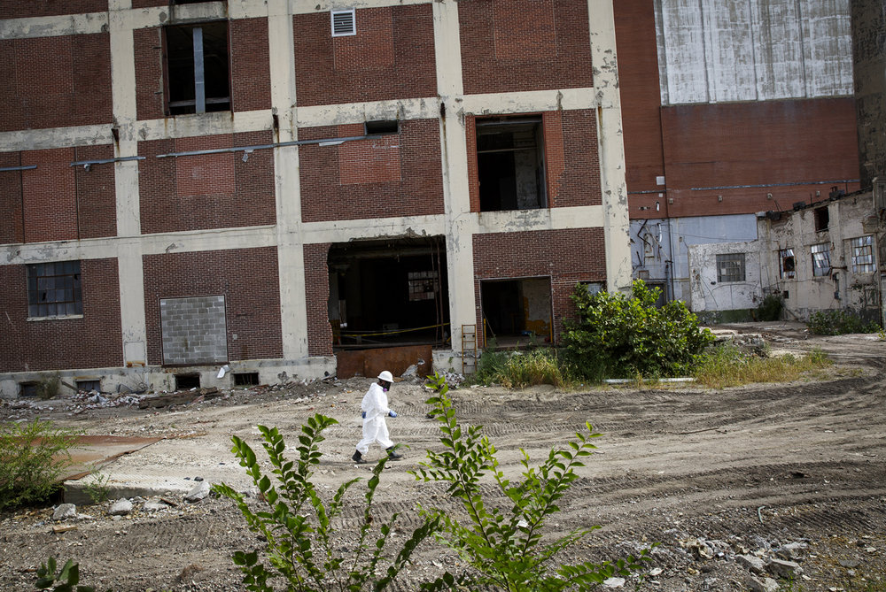 A U.S. Environmental Protection Agency employee walks through the former Pillsbury Mills site Thursday, Aug. 31, 2017. [Rich Saal/The State Journal-Register]