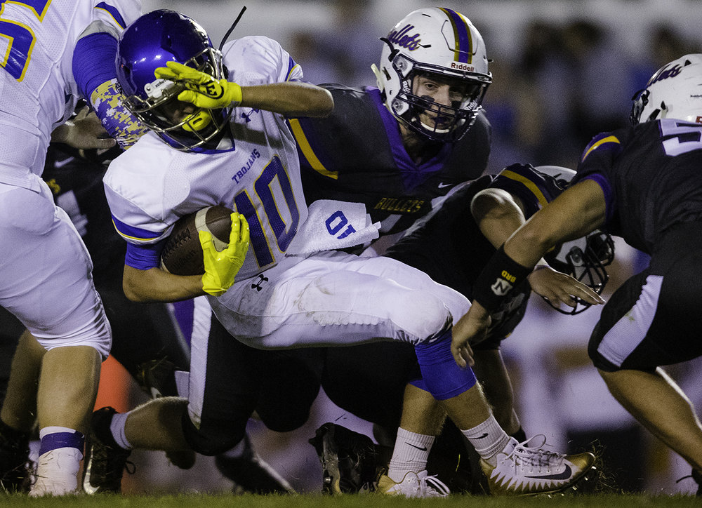 Maroa-Forsyth's Kameron Boline tries to spin away from Williamsville's Grant Daykin at Williamsville High School Friday, Sept. 8, 2017. [Ted Schurter/The State Journal-Register]