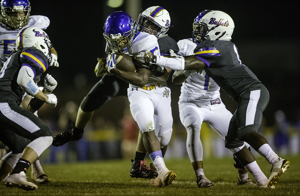 Williamsville's Zeke Kern wraps up Maroa-Forsyth's Deondre Gregory at Williamsville High School Friday, Sept. 8, 2017. [Ted Schurter/The State Journal-Register]