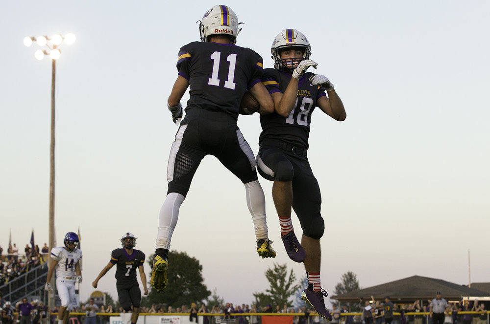 Williamsville's Hunter Thompson, left, and Williamsville's Bryan Rapp celebrate Thompson's first-half touchdown at Williamsville High School Friday, Sept. 8, 2017. [Ted Schurter/The State Journal-Register]