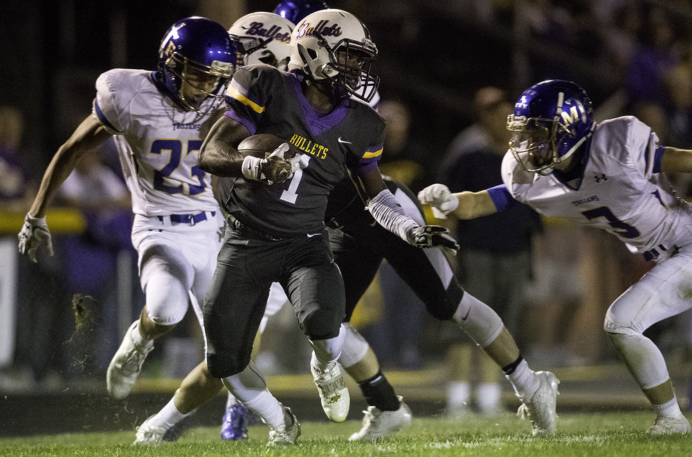 Williamsville's Daetayvian Woodson evades Maroa-Forsyth's Noah Holthaus at Williamsville High School Friday, Sept. 8, 2017. [Ted Schurter/The State Journal-Register]