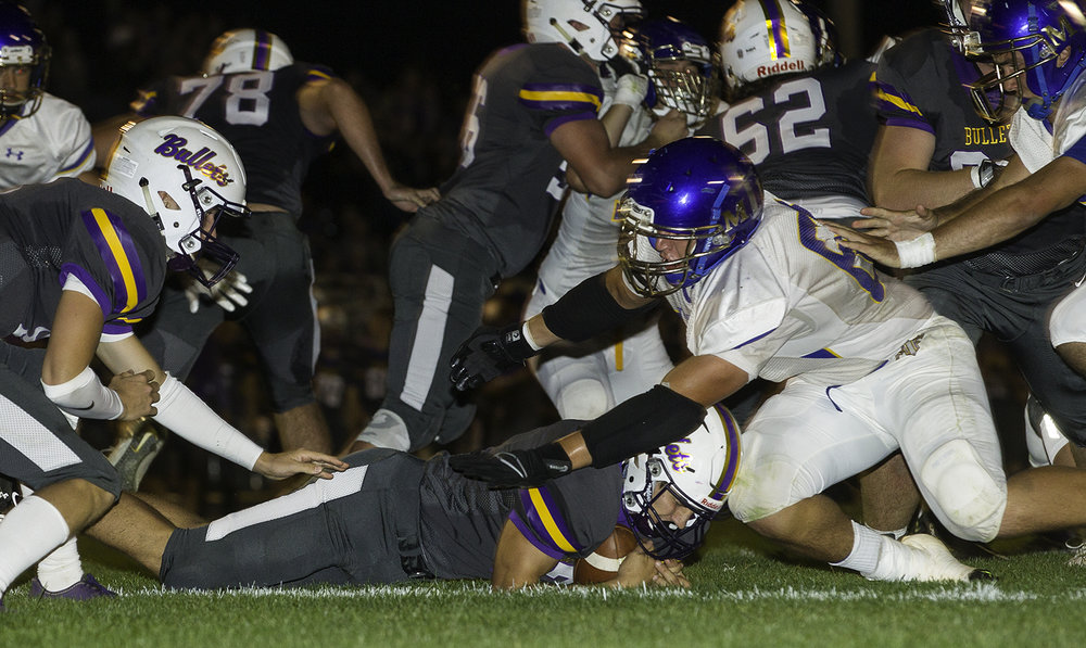 Williamsville's Keegan McGann dives onto a loose ball in front of Maroa-Forsyth's Bryson Fogerson at Williamsville High School Friday, Sept. 8, 2017. [Ted Schurter/The State Journal-Register]