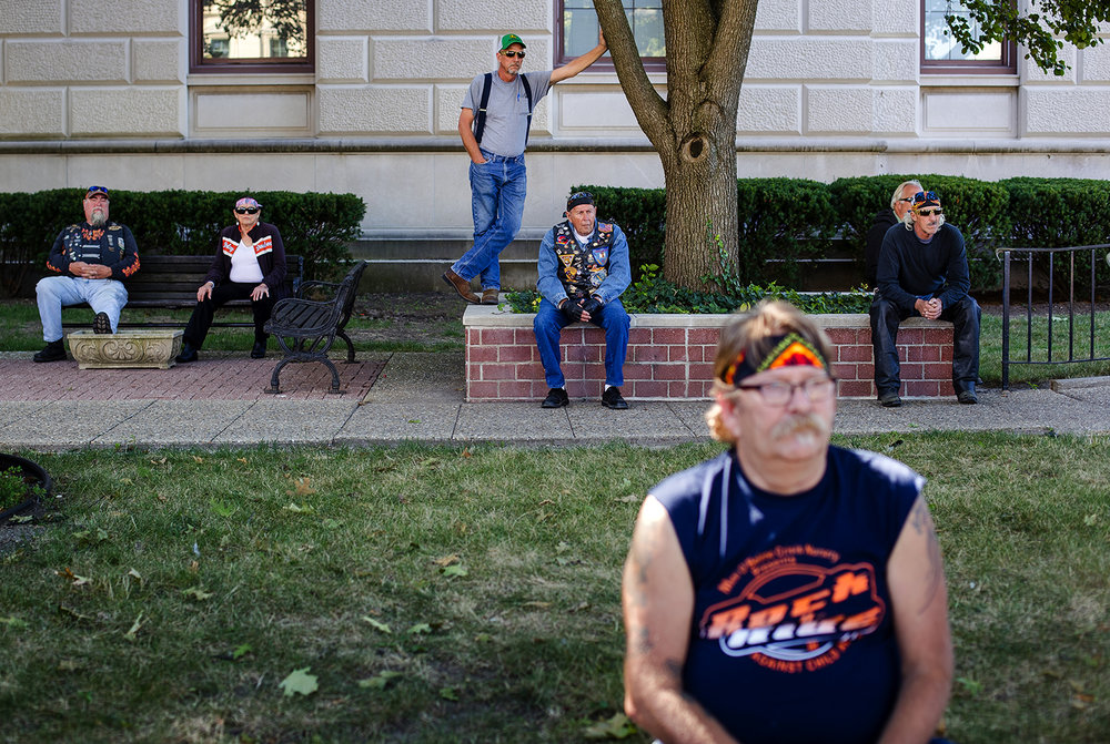 Audience members rest in the shade of the State Archives building as they listen to speeches during the Ride To Remember 9-11 Annual Memorial Parade & Ceremony on the Capitol grounds Sunday, Sept. 10, 2017. [Ted Schurter/The State Journal-Register]