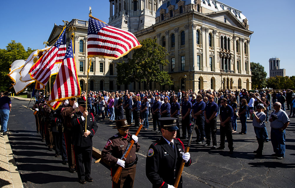 Members of the color guards from the Springfield Police and Fire departments and the Sangamon County Sheriff's department post the colors during the Ride To Remember 9-11 Annual Memorial Parade & Ceremony on the Capitol grounds Sunday, Sept. 10, 2017. [Ted Schurter/The State Journal-Register]