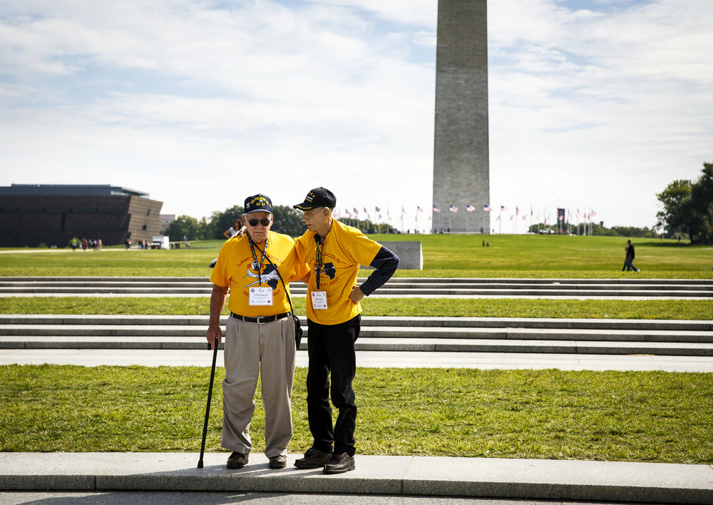 Long time friends Ted Christen, left, and Jack Stevens, who are from Springfield and served together in the Korean War, paused at the edge of the World War II Memorial on the National Mall.