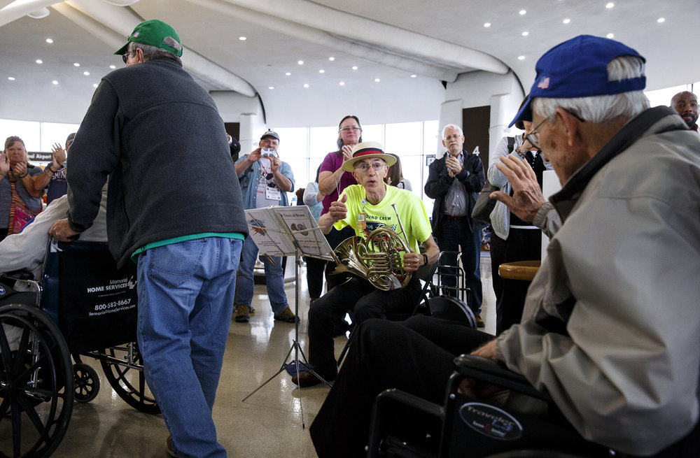 Andy Leighton was on hand to play the French horn and welcome the veterans on the Land of Lincoln Honor Flight after their arrival at Ronald Reagan Washington National Airport.
