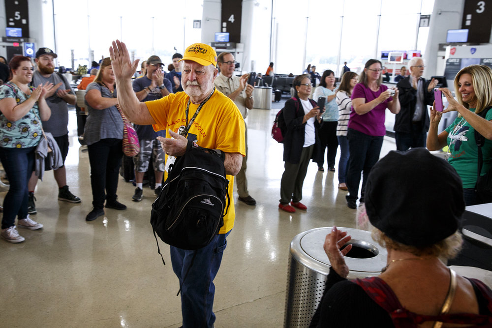 Elmer Fred thanks passengers who greeted the Land of Lincoln Honor Flight after its arrival at Ronald Reagan Washington National Airport. Fred is a U.S. Army veteran of the Korean War.
