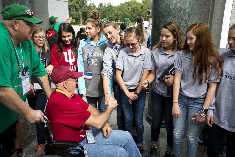 Students from St. Maria Goretti Catholic Grade School in Indiana on their 8th grade school trip, greet Bob Schuller of Springfield, a U.S. Marine veteran of the Vietnam War, at the World War II Memorial.