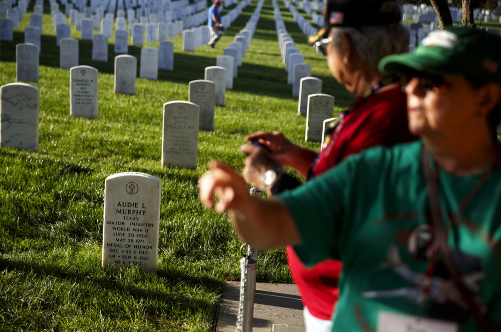 Honor Flight veterans paused at the grave of Audie Murphy in Arlington National Cemetery Tuesday, Sept. 12, 2017. Murphy was one of the most decorated American combat soldiers of World War II, who after the war achieved fame as an actor and entertainer. [Rich Saal/The State Journal-Register]